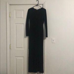 Black low cut high slit dress